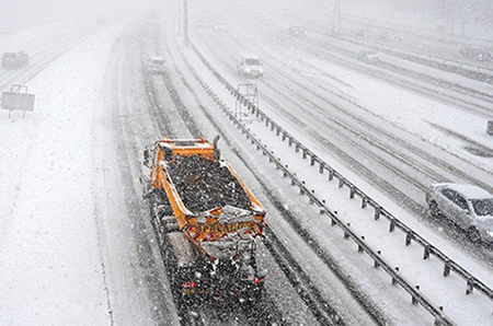 Image of Ringway gritter in winter driving through SW England